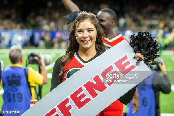 The Georgia Bulldogs cheerleaders entertain the crowd during the Sugar Bowl game between the Georgia Bulldogs and the Baylor Bears on January 01 at...