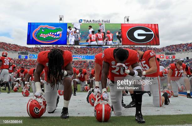The Georgia Bulldogs take a knee during a game against the Florida Gators at TIAA Bank Field on October 27 2018 in Jacksonville Florida