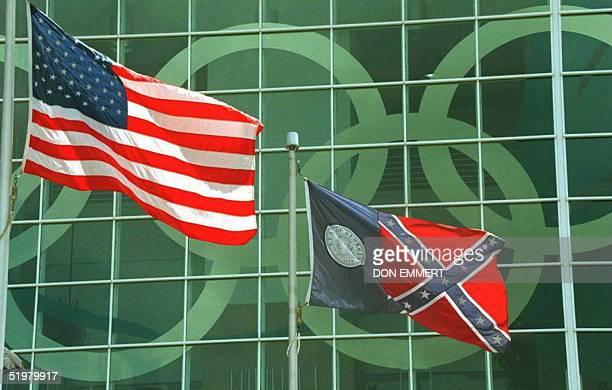 The Georgia state flag which incorporates the Confederate flag flies next to the US flag 12 July outside the Georgia Dome as Atlanta prepares for the...