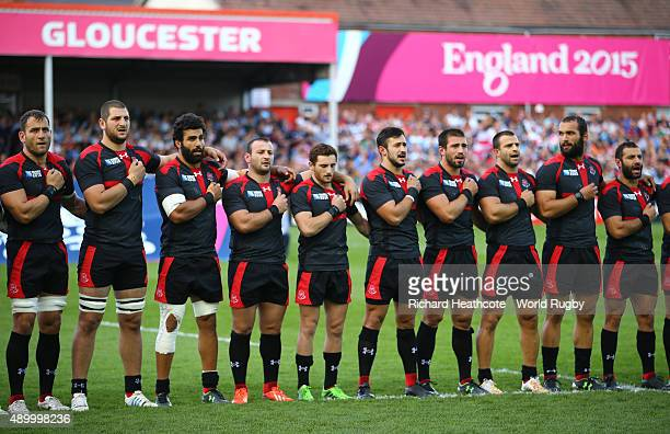 The Georgia team sing the national anthem during the 2015 Rugby World Cup Pool C match between Argentina and Georgia at Kingsholm Stadium on...