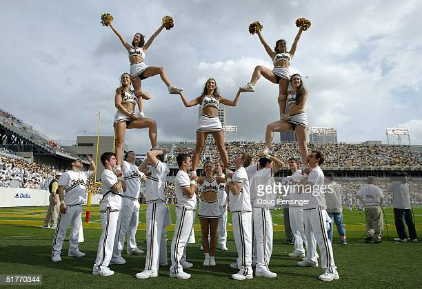 The Georgia Tech cheerleaders perform a stunt as the Virginia Cavaliers defeated the Yellow Jackets 3010 during NCAA football action at Bobby Dodd...