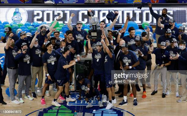 The Georgia Tech Yellow Jackets celebrate defeating the Florida State Seminoles in the ACC Men's Basketball Tournament championship game at...