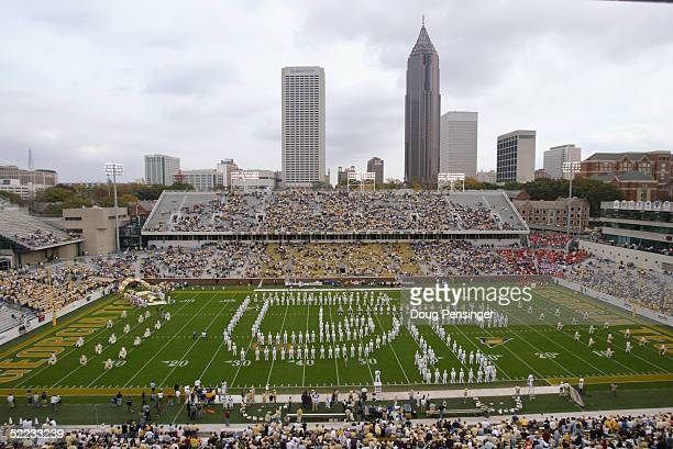 """The Georgia Tech Yellow Jackets Marching Band spells """"GT"""" during an intermission in the game against the University of Virginia Cavaliers at Bobby..."""
