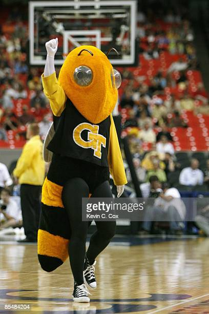 The Georgia Tech Yellow Jackets mascot celebrates on court against the Clemson Tigers during day one of the 2009 ACC Men's Basketball Tournament on...