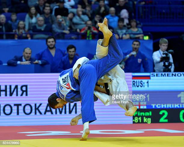 The Georgian men's team defeated the Russian team by 3 contests to 2 to win the gold medal. Here, Avtandili Tchrikishvili of Georgia throws Stanislav...