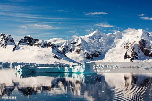 the gerlache strait separating the palmer archipelago from the antarctic peninsular off anvers island. the antartic peninsular is one of the fastest warming areas of the planet. - polar stock pictures, royalty-free photos & images