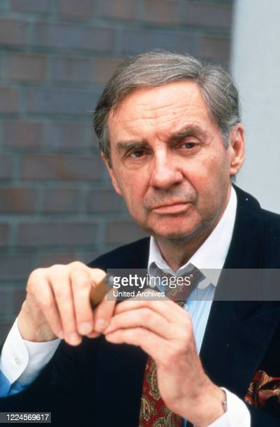 The German actor entertainer voice actor and singer Harald Juhnke poses for a photo with a cigar circa 1990s