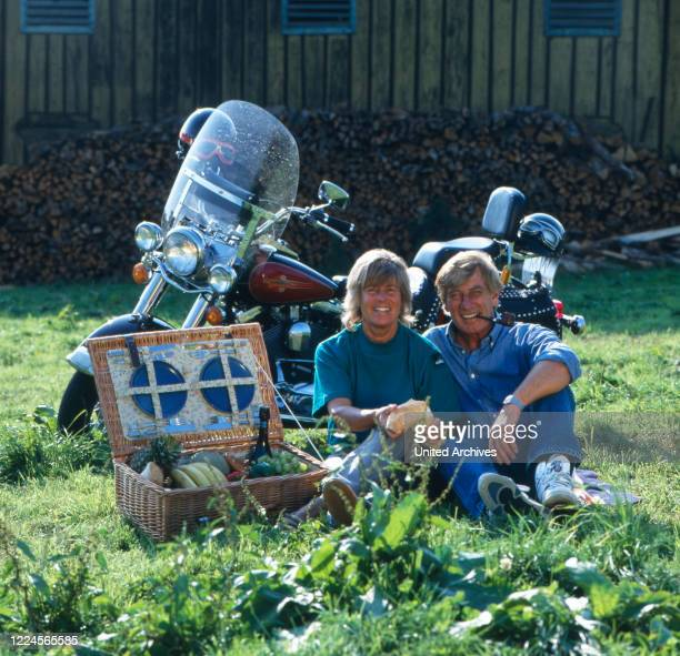 The german actor Siegfried Rauch and his wife Karin are portrayed with his motorbike, Germany, 1980.