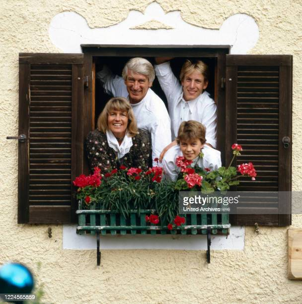 The german actor Siegfried Rauch is looking together with his wife and his children out of the window, Germany, 1980.