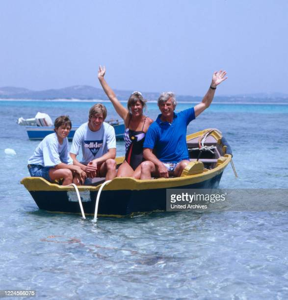 The german actor Siegfried Rauch with his family in a boat, probably Mediterranean Sea 1980.