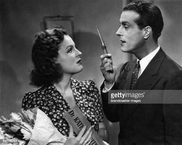 """The German actors Magda Schneider and Wolf Albach-Retty in the movie """"Zwei glückliche Menschen"""". Germany. Photograph. 1942."""