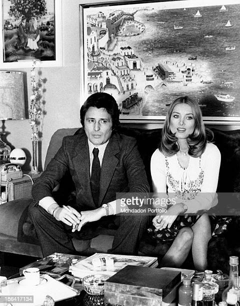 The German actress Barbara Bouchet seated beside her husband Luigi Borghese a movie producer she married last year they're in the sitting room of...