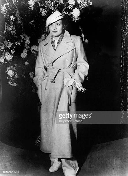 The German Actress Marlene Dietrich Wearing Men'S Pants And A Trenchcoat In Paris In 1933.