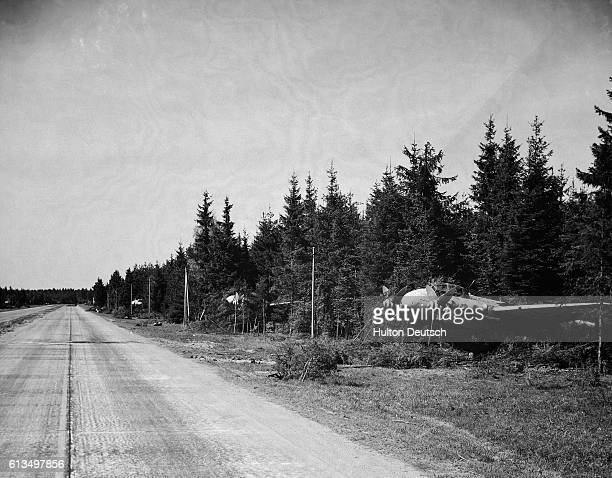 The German air force uses an autobahn as a runway Junkers and Messerschmitt aircraft are hidden in the woods alongside the autobahn
