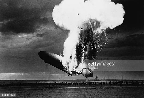 The German airship Hindenburg falls to the ground as the hydrogen gases that kept it aloft explode in a gigantic fireball The explosion occurred...