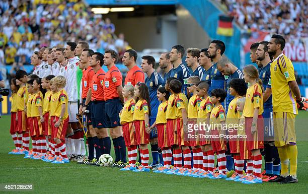 The German and Argentina teams line up prior the 2014 FIFA World Cup Brazil Final match between Germany and Argentina at the Maracana on July 13 2014...