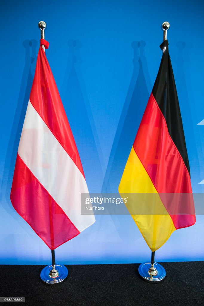The German and the Austrian flags are pictured after a press conference held from German Interior Minister Horst Seehofer and Austrian Chancellor Sebastian Kurz at the Interior Ministry in Berlin, Germany on June 13, 2018.