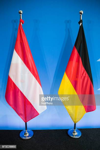 The German and the Austrian flags are pictured after a press conference held from German Interior Minister Horst Seehofer and Austrian Chancellor...