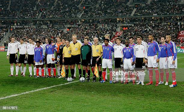 The German and the French team stand together to demonstrate against violence during the international friendly match between France and Germany at...