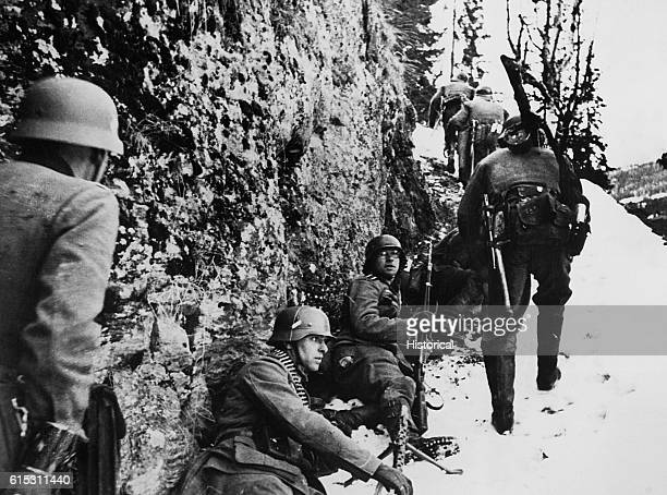 The German army progresses along a narrow trail into the interior of Norway but her defenders make it less than a Sunday stroll during World War II