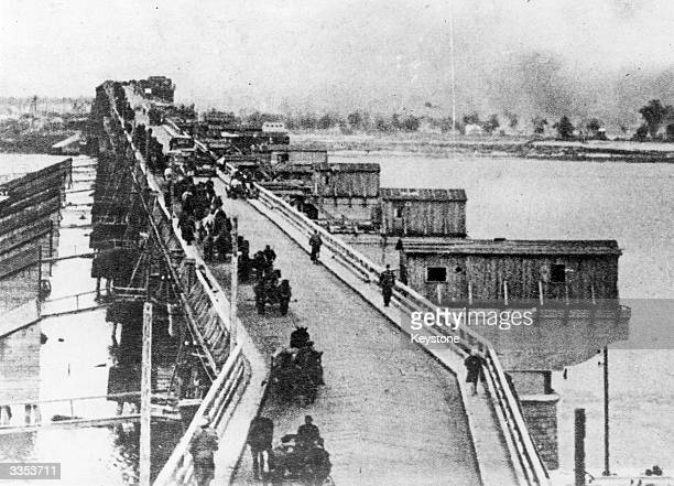 The German army retreating from Russian forces across the last crossable bridge over the Dneiper river, the other bridges having been blown up by...