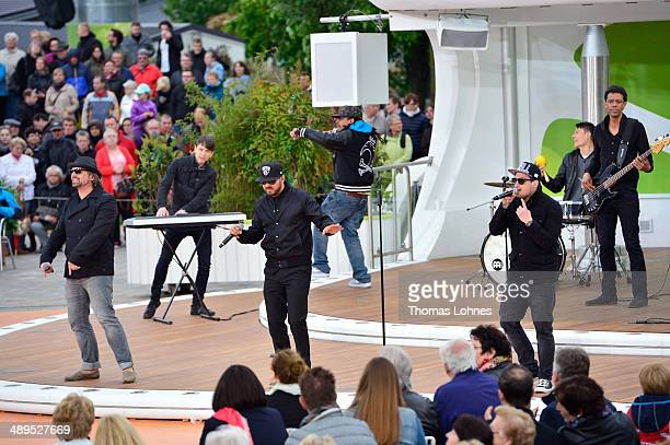 The German band 'Soehne Mannheims' perform during the TV Show 'ZDF Fernsehgarten' on May 11 2014 in Mainz Germany