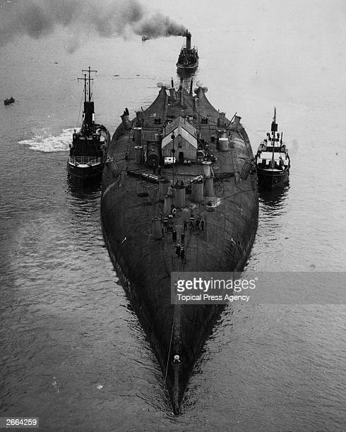 The German battle cruiser 'Prinz Regent Luitpold' being towed back to Rosyth keel uppermostThis is one of many German ships sunk by her crew in Scapa...
