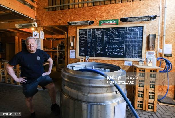 The German brewer Torsten Schumacher poses for a photo after he provides the kettles of his brewery for the production of disinfectants on April 8...
