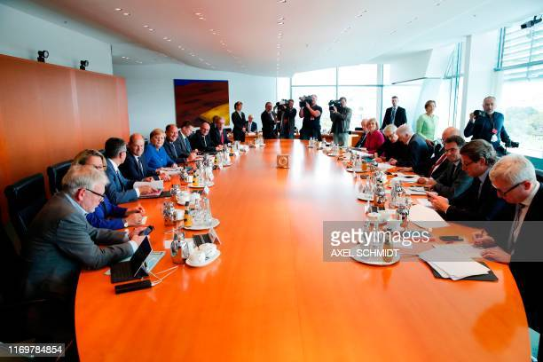 The German cabinet with German Chancellor Angela Merkel wait ahead a climate cabinet meeting on September 20 2019 in Berlin Chancellor Angela...