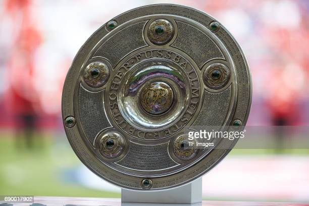 The German Championship trophy is displayed prior the Bundesliga match between Bayern Muenchen and SC Freiburg at Allianz Arena on May 20 2017 in...
