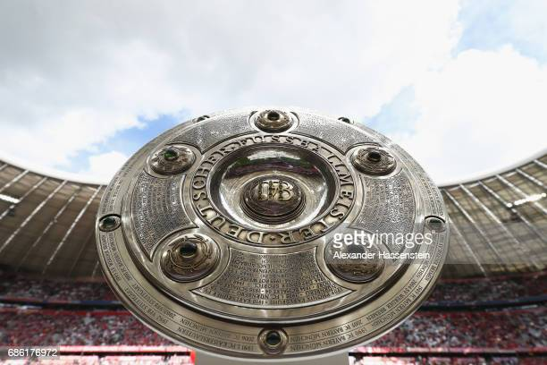 The German Championship trophy is displayed prior to the Bundesliga match between Bayern Muenchen and SC Freiburg at Allianz Arena on May 20 2017 in...