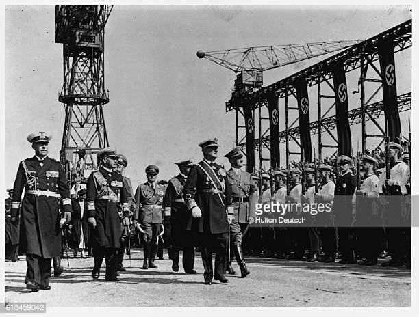 The German Chancellor Adolf Hitler inspecting a group of sailors at Kiel accompanied by Frau von Horthy