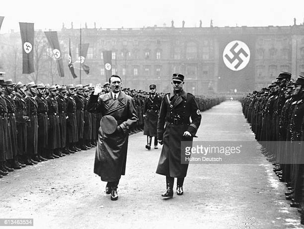 The German Chancellor Adolf Hitler with Herr Lutze his chief of staff during a review of the storm troopers in Berlin to mark the third anniversary...