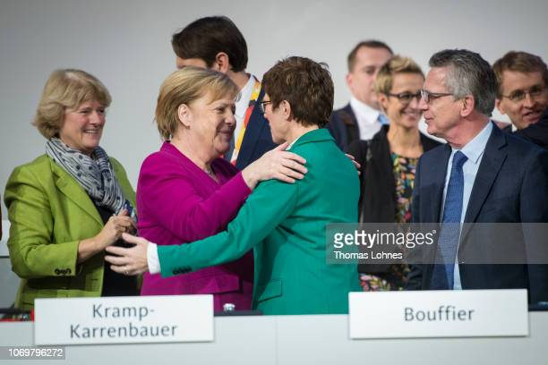 The German Chancellor Angela Merkel hugs the new leader of the German Christian Democrats Annegret KrampKarrenbauer at the end of the federal...