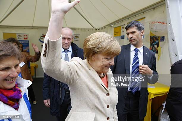 REGENSBURG BAVARIA GERMANY The German Chancellor Angela Merkel leaves the stall of the charity In Via at the Katholikentagsmeile waving at the...