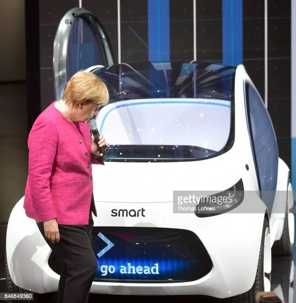 The German Chancellor Angela Merkel looks at a Smart Vision EQ concept car during her visit at the presentation of the carmaker MercedesBenz at the...