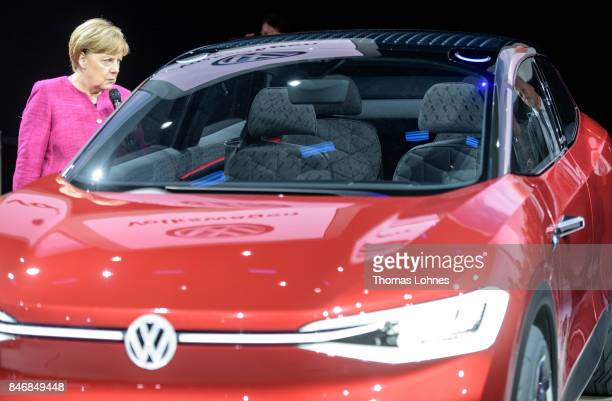 The German Chancellor Angela Merkel looks into a Volkswagen ID Crozz electric crossover concept car during her visit at the 2017 Frankfurt Auto Show...