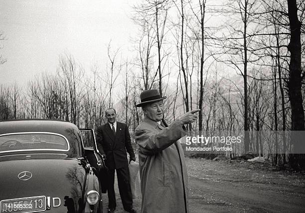 The German Chancellor Konrad Adenauer pointing one's finger at something during a walk. Ascona, 1956