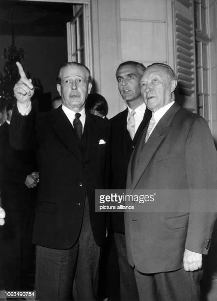 The German chancellor Konrad Adenauer the British prime minister Harold Macmillan and the undersecretary in the British foreign ministry David...