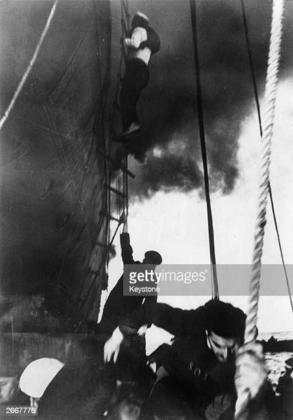The German crew of the Norddeutscher Lloyd liner Columbus retire to the lifeboats after setting the ship ablaze and scuttling her in the western...
