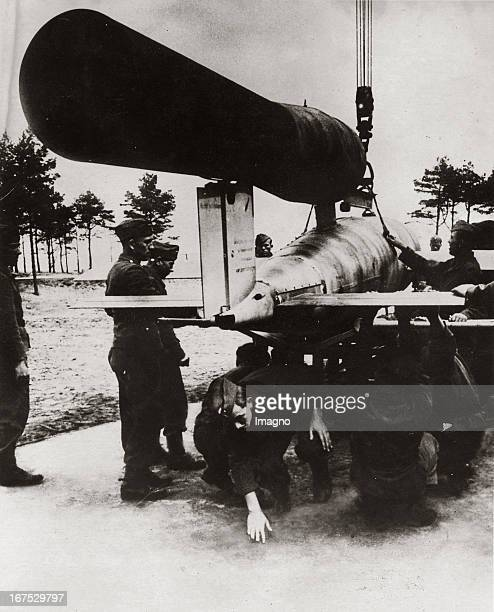 The German cruise missile V1 is be rolling to the launch pad August 1944 Photograph Der deutsche Marschflugkörper V1 wird aus einer unterirdischen...
