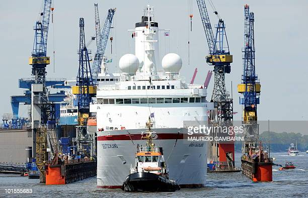 The German cruise ship MS Deutschland is brought to the docks of the Blohm Voss shipyard in Hamburg northern Germany on June 2 2010 Rescuers had...