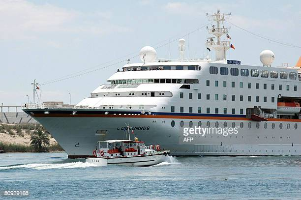 The German cruise ship the 'CColumbus' cruises along the Suez Canal sailing from Dubai towards the Mediterranean Sea past the Egyptian city of...