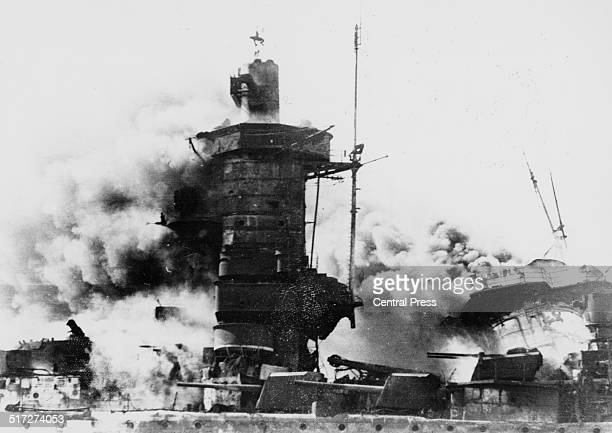 The German cruiser Admiral Graf Spee on fire after being scuttled by her captain in Montevideo harbour Uruguay 17th December 1939 The ship had been...
