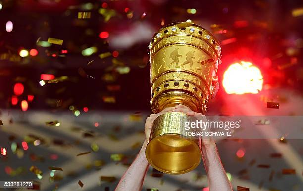The German cup trophy is lifted during the winners ceremony after Bayern Munich won the German Cup final football match Bayern Munich vs Borussia...