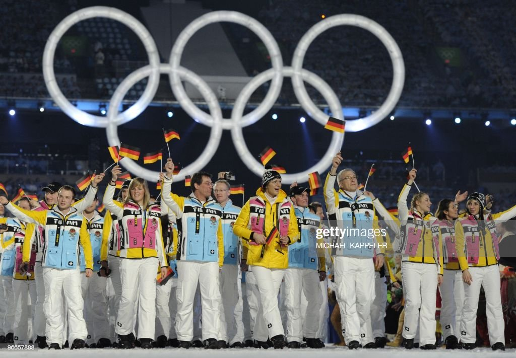 The German delegation with skier Maria Riesch (C) and speedskater Anni Friesinger (R) enters the stage at BC Place during the opening ceremony of the 2010 Winter Olympics in Vancouver on February 12, 2010.