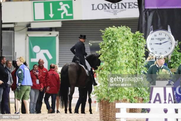 The German dressage rider Dorothee Schneider on horse Sammy Davis Jr. Looks around during the dressage Grand Prix at the European Equestrian...