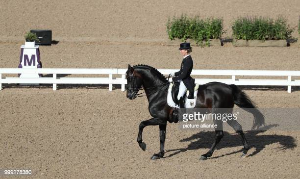 The German dressage rider Helen Langehanenberg on horse Damsey can be seen during the Grand Prix of the teams at the European Equestrian...