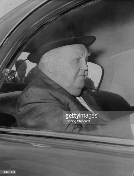 The German economist and politician Ludwig Erhard in the back seat of a car
