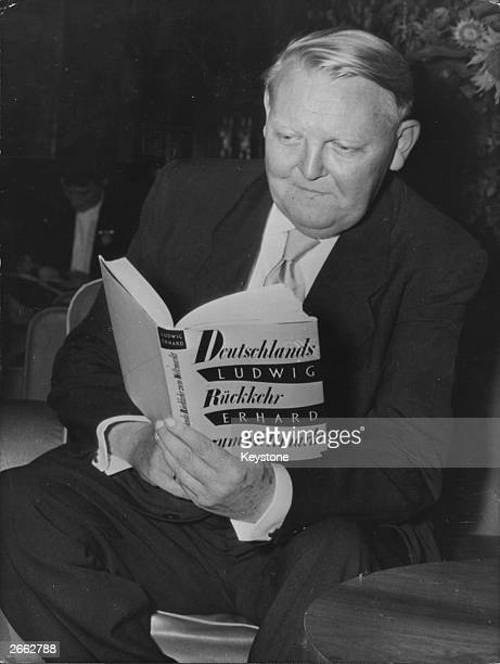 The German economist and politician Ludwig Erhard receives a copy of his book in Wiesbaden Original Publication People Disc HD0067